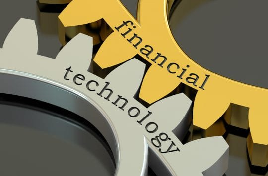Financial Technology concept on the gearwheels, 3D rendering