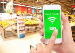 Mobile payment concept, Blur supermarket background, business and financial, technology.