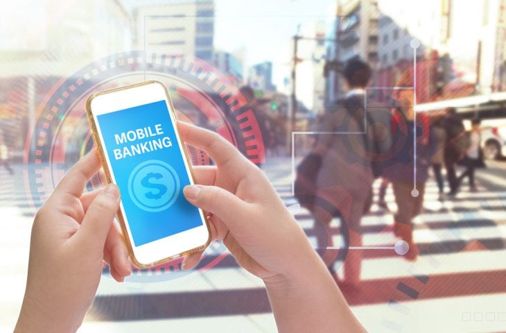 Hands holding mobile phone with Mobile banking, Mixed with business graphic background